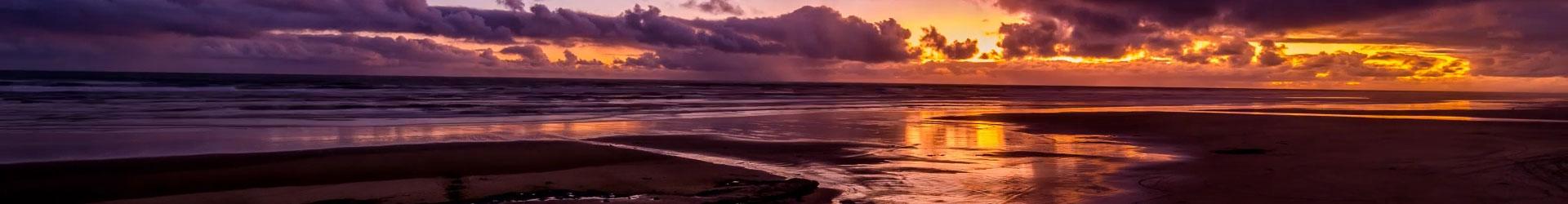 https://www.dargavillenz.com/uploads/images/Beach-sunset-banner.jpg